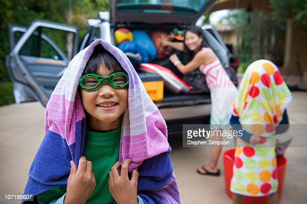 Family packing the family car for vacation
