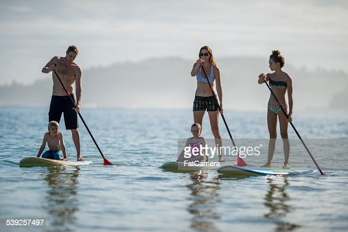 Family paddleboarding in Hawaii