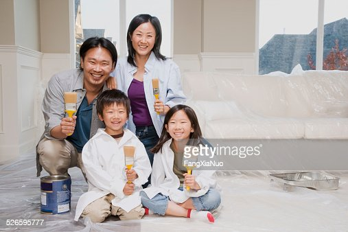 Family Painting a Room in Their Home
