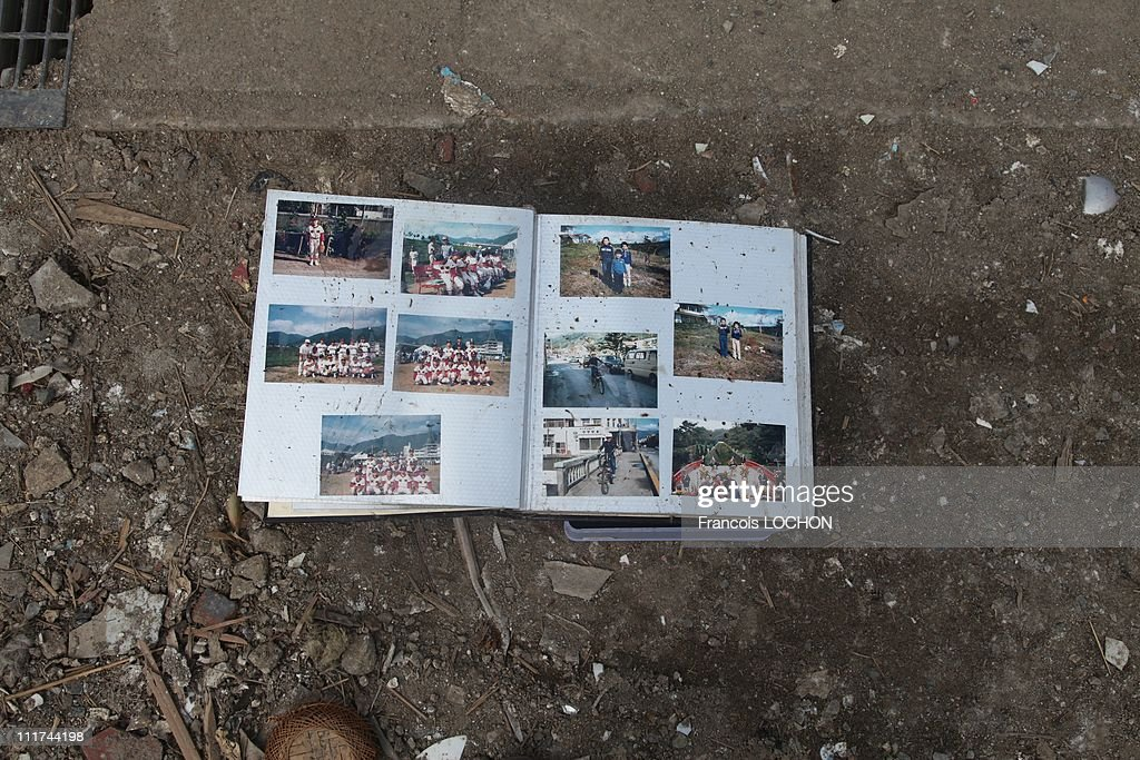 A family photo album is left in the rubble destroyed by the earthquake on April 4,2011, in Myako,Japan. These objects are from the 30 000 victims of the earthquake that hit Japan on March 11, 2011 followed by an tsunami.