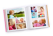 Photo book with various family photos on white background