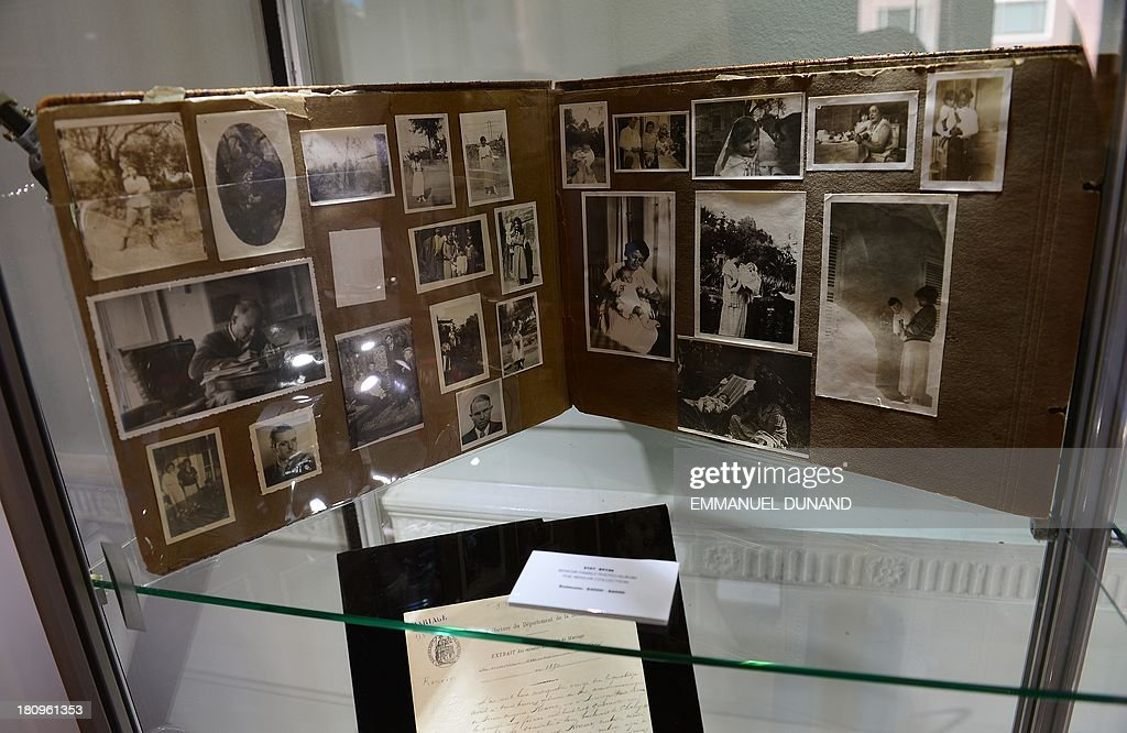 A family photo album which belonged to late French artist Pierre-August Renoir is on display at Heritage Auctions in New York, September 18, 2013.The single-largest archive of Renoir's personally-owned object, sculptures and letters are set to go on auction on September 19, 2013. AFP PHOTO/Emmanuel Dunand