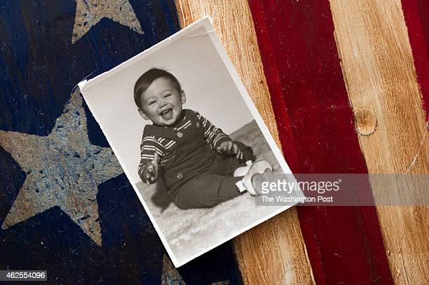 A family photo of Patrick Costello III of Manassas Va when he was twoyearsold before his family realized he was going deaf is displayed at his...