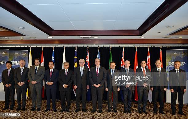A family photo shows trade ministers from the TransPacific Partnership a panPacific trade agreement from 12 nations Lim Jock Hoi from Brunei...