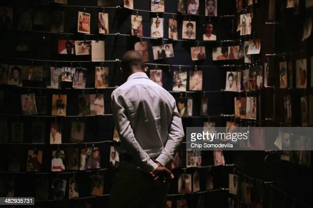 Family photos of victims of the 1994 Rwanda genocide hang inside the Kigali Genocide Memorial Centre April 5 2014 in Kigali Rwanda Rwanda is...