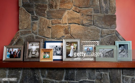 Family Photos on Mantle Large Group : Stock Photo