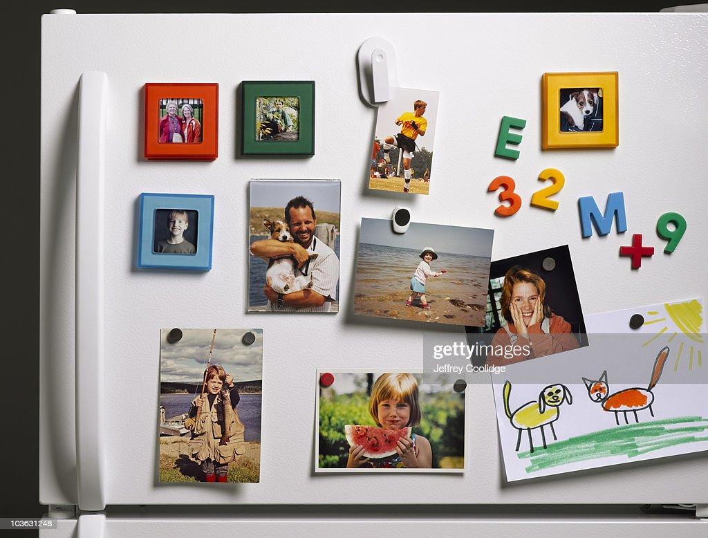 Family Photos on Refrigerator : Stock Photo