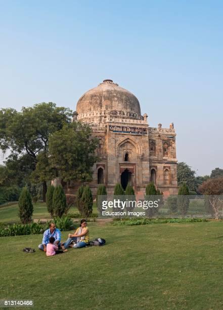 Family Picnic outside Shisha Gumbad in Lodhi Lodi Gardens New Delhi India