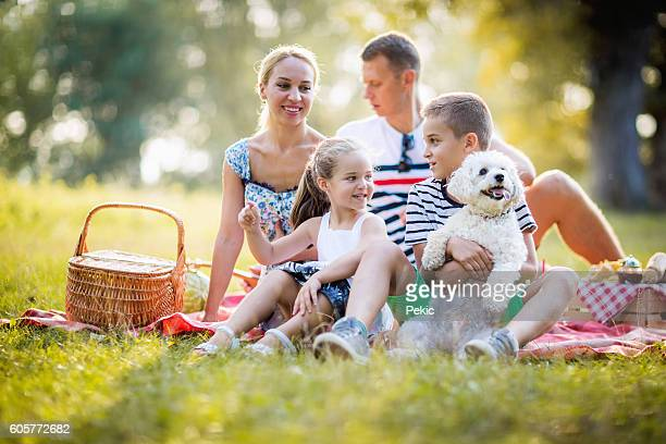 Family picnic with a cute dog