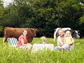 Family picnicing in middle of field