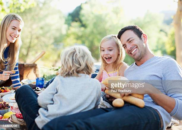 Family picnicking together on grass