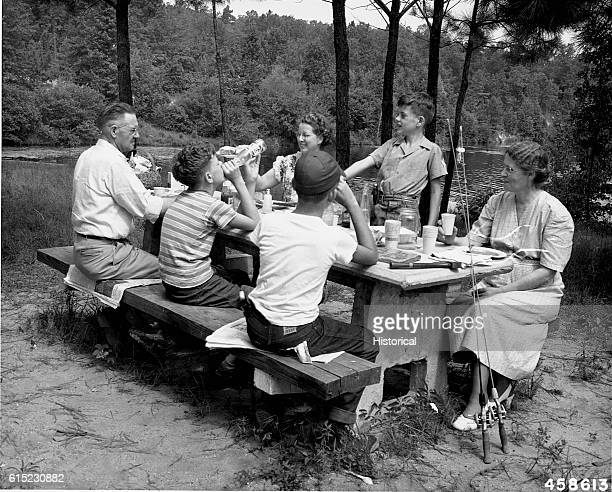 A family picnics on the shore of Payne Lake Talladega National Forest Alabama 1949 | Location Payne Lake Recreation Area Talladega National Forest...