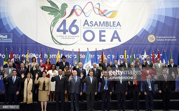 Family picture of the Organization of American States' XLVI General Assembly being held in Guatemala City on September 19 2014 AFP PHOTO / Johan...