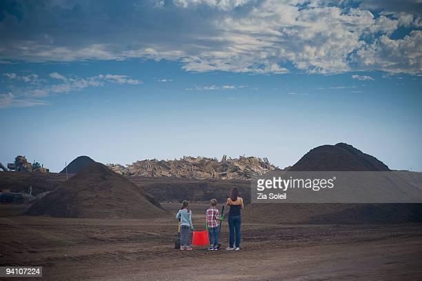 family & piles of free mulch, municipal landfill