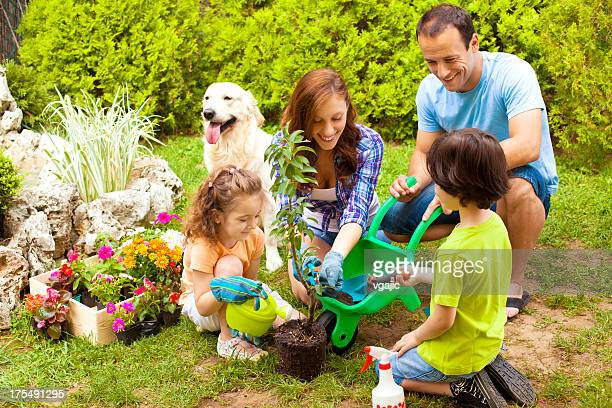 Family Planting Flowers Together.