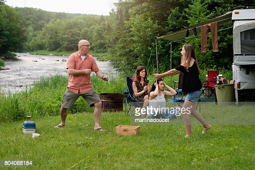 Family playing and relaxing in summer camping. : Stock Photo
