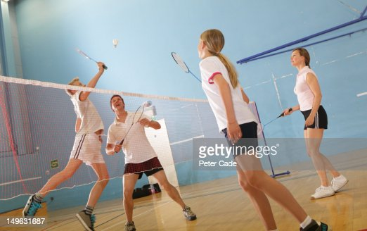 family playing badminton