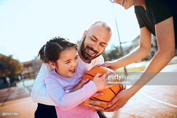 Family playing basketball
