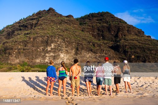 Family playing bocce at Polihale State Beach Park. : Stock Photo