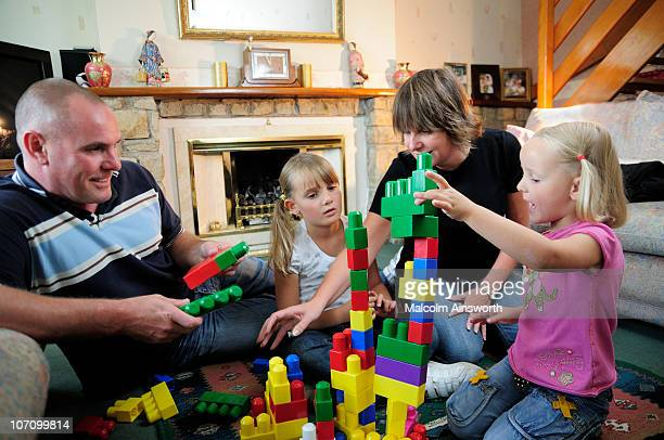 Family playing building blocks