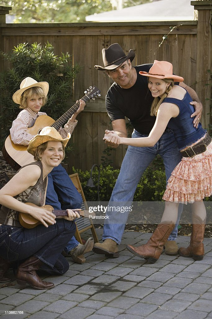 Family playing country music and dancing : Stock Photo