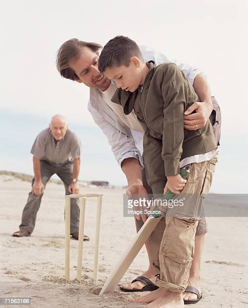 Family playing cricket