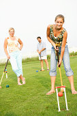 Family playing croquet