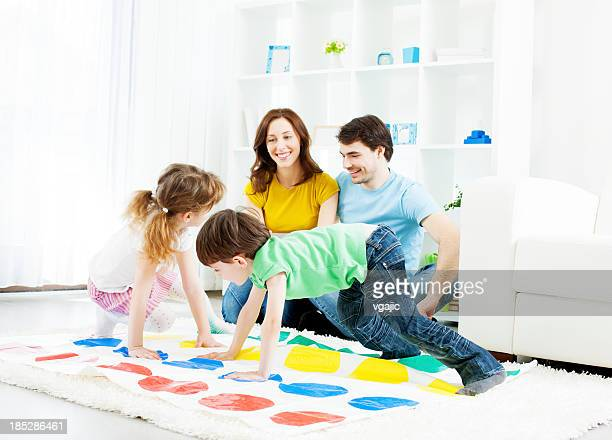 Family playing floor game.