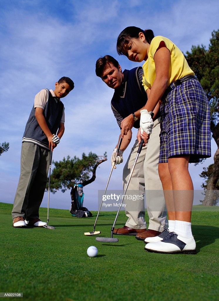 Family Playing Golf on Putting Green : Stock Photo