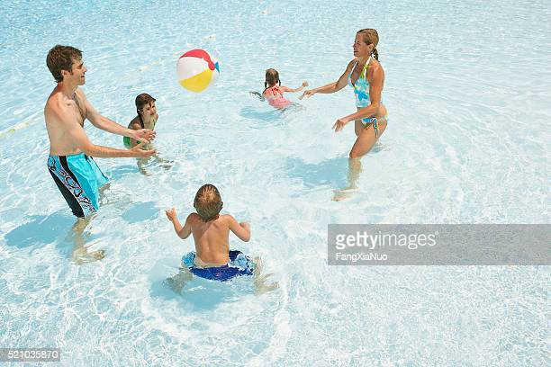 Family playing in a wading pool