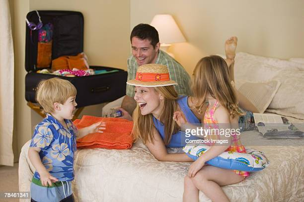 Family playing in hotel room during tropical vacation