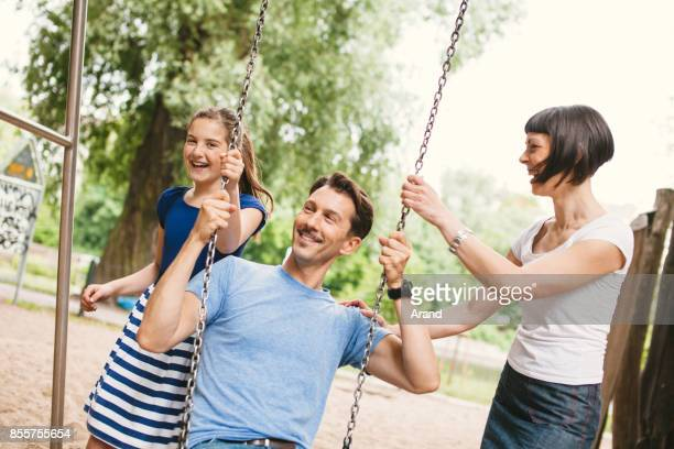 Family playing in park