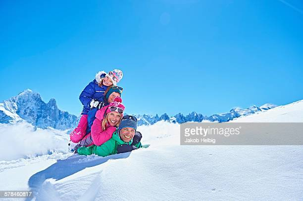 Family playing in snow, Chamonix, France