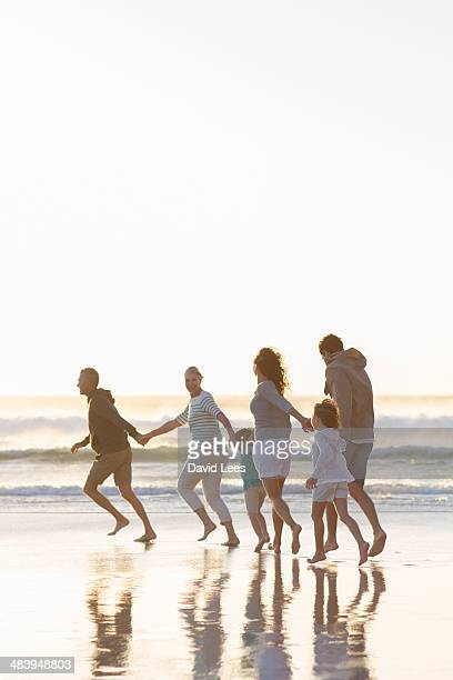 Family playing in surf at beach