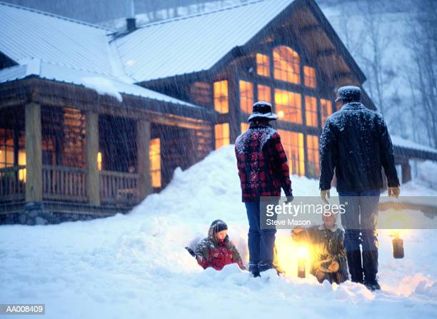 Family Playing in the Snow Outside a Ski Lodge