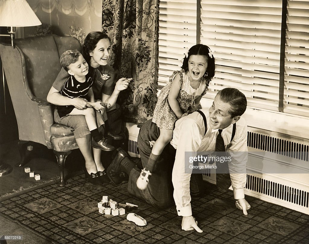 Family playing indoors : Stock Photo