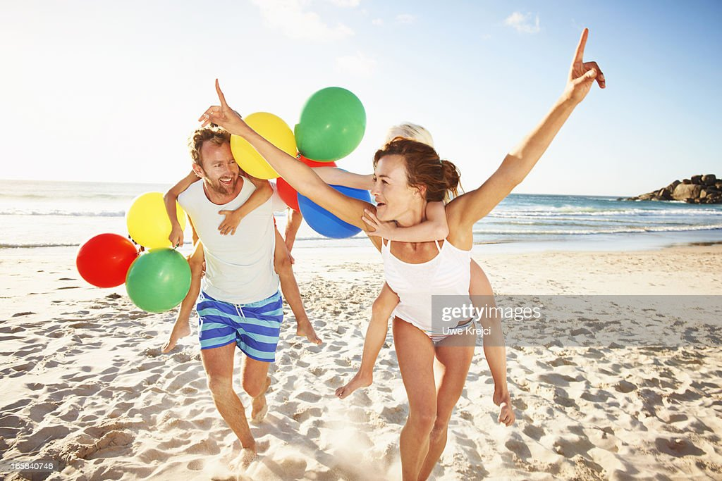 Family playing on beach : Stock Photo