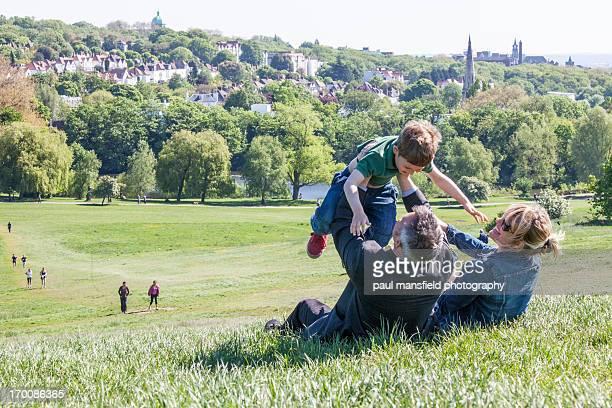 Family playing on Hampstead Heath