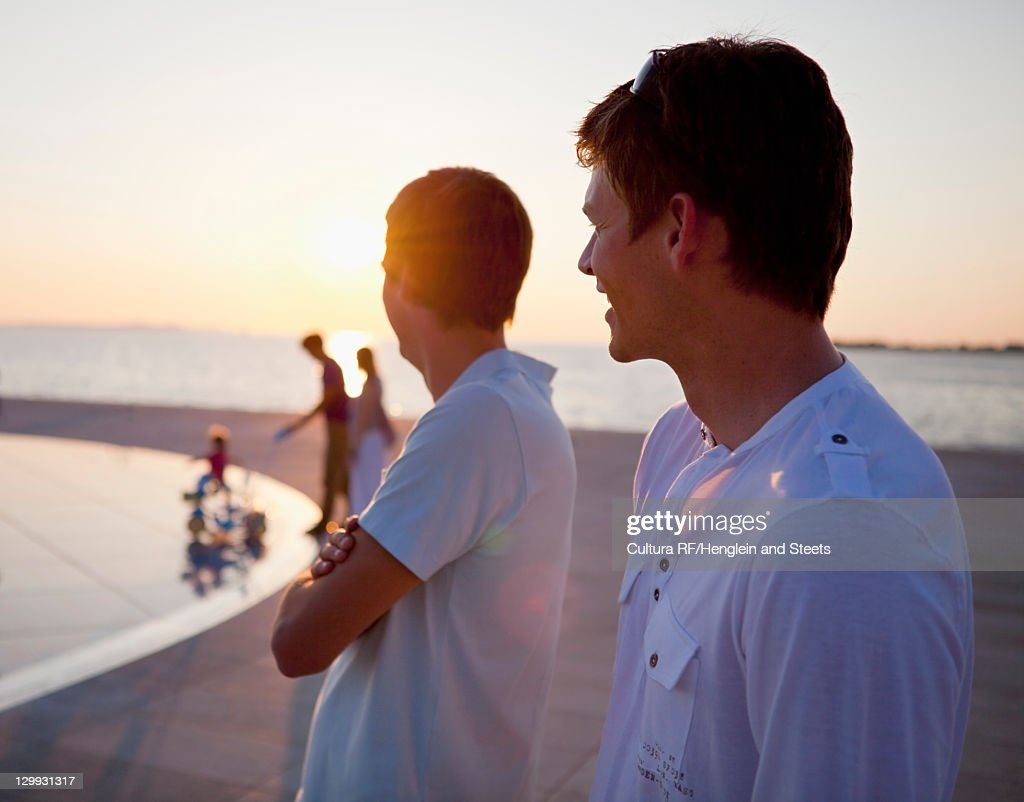 Family playing on pier outdoors : Stock Photo