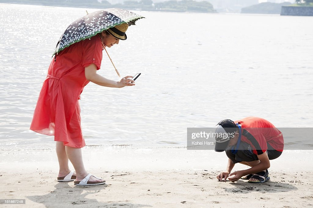 family playing on the beach : Stock Photo