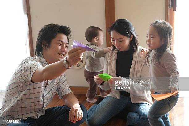 Family Playing Origami Together
