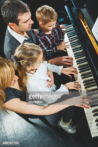 Family playing piano.