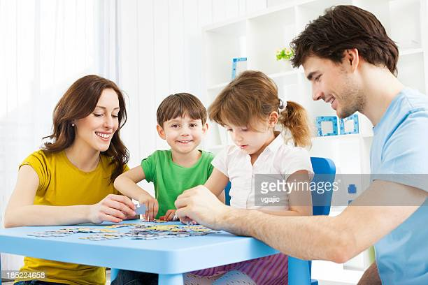 Family Playing Puzzle Game at home.