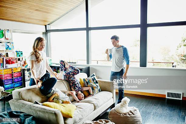 Family playing together in living room of home