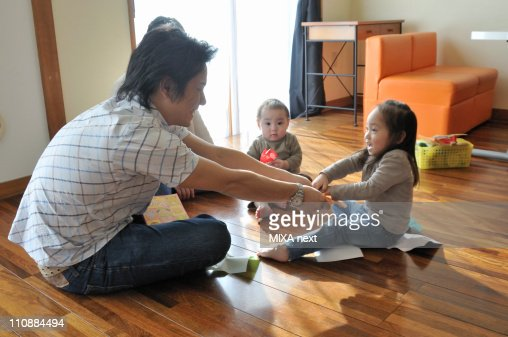 Family Playing Together in Living Room : Stock Photo