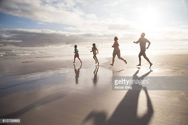 Family playing together on a beach