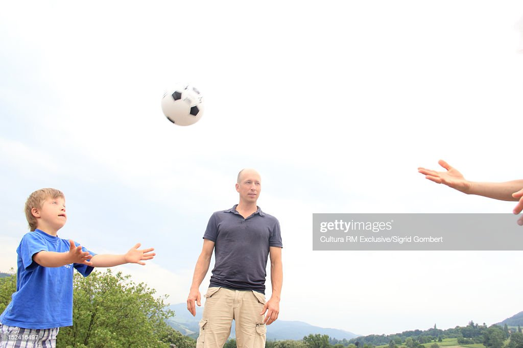 Family playing together outdoors : Stock Photo