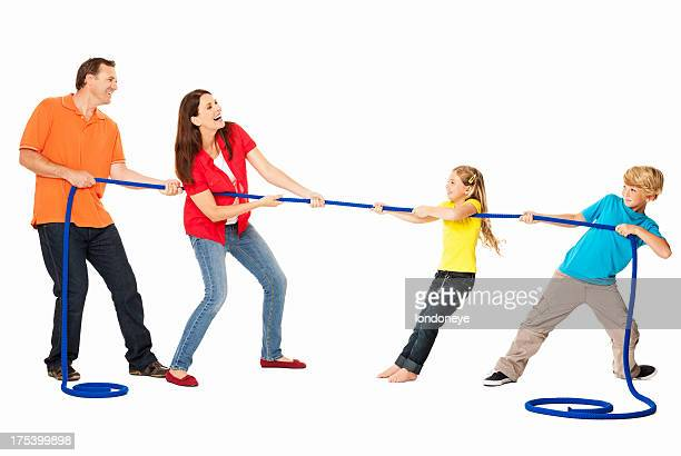 Family Playing Tug Of War - Isolated