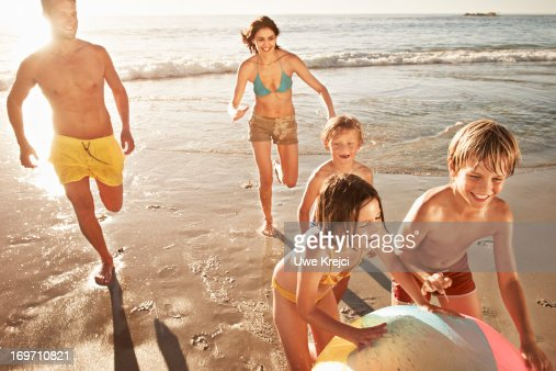 Family playing with beach ball : Stock Photo