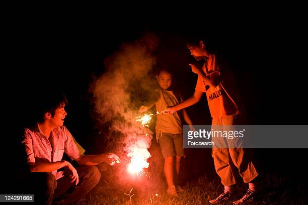 Family Playing with Hand-Held Fireworks Together